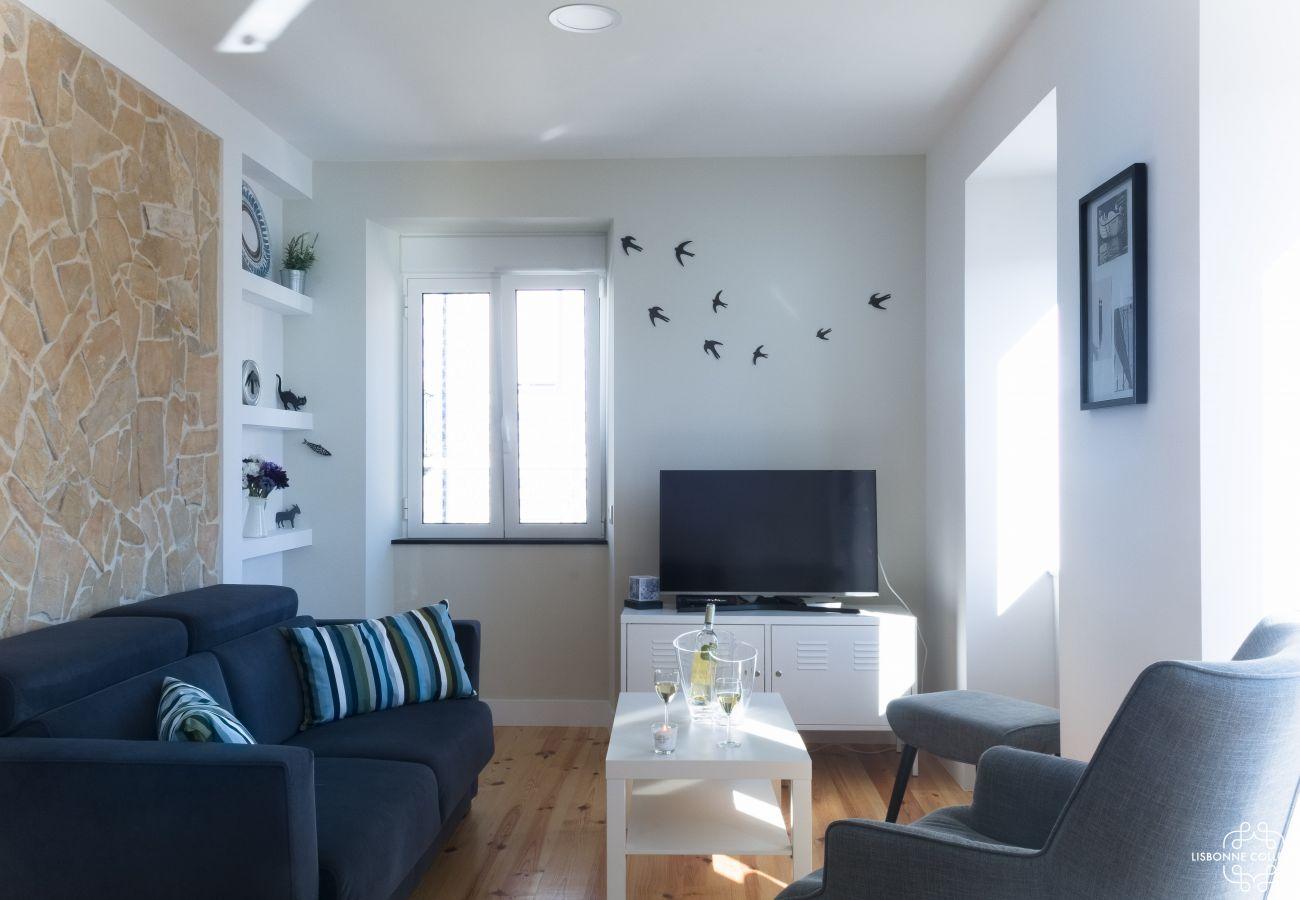Grande sala convertida em arrendamento para uma estadia em Lisboa
