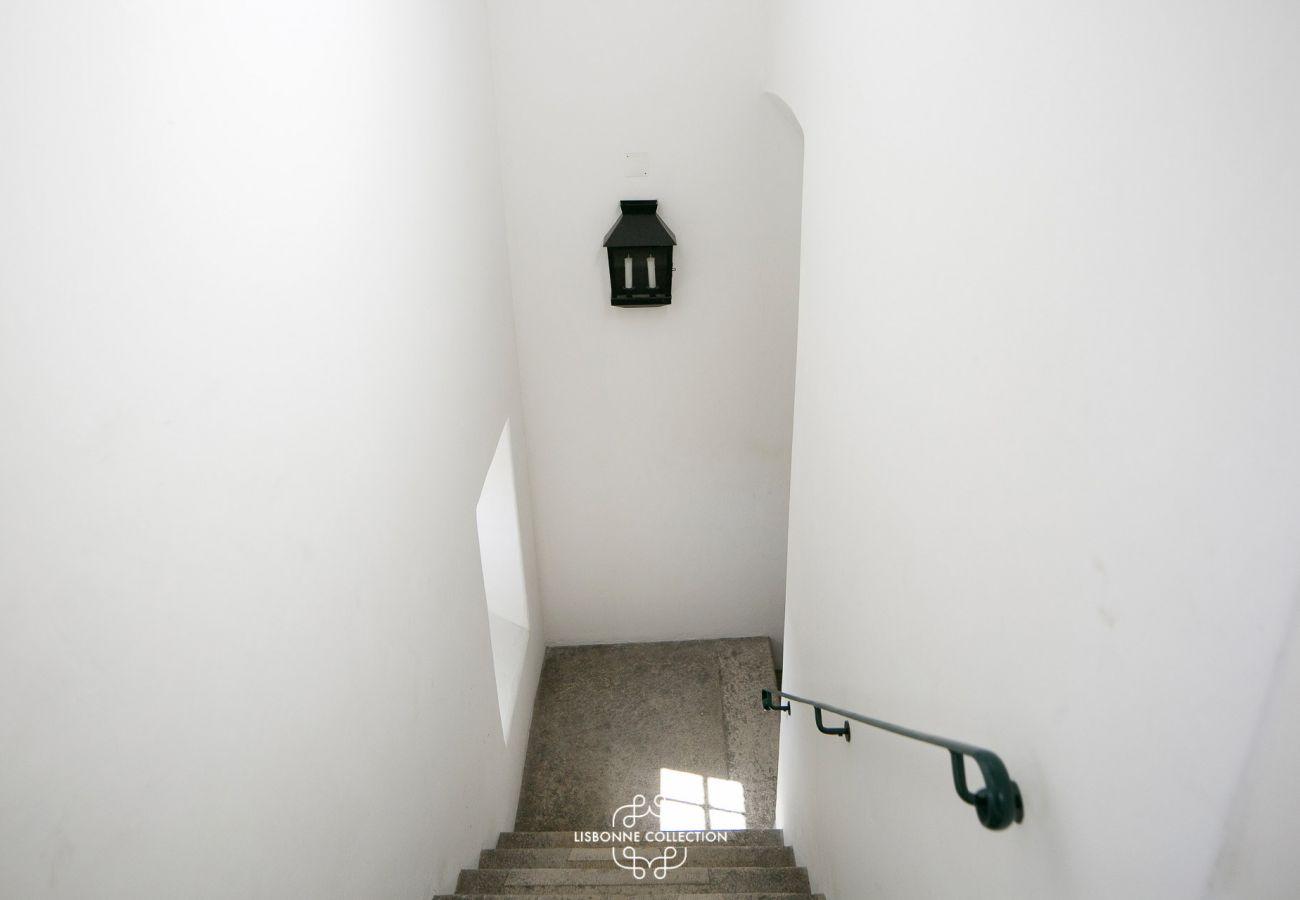 Entrada para o prédio onde o apartamento está localizado